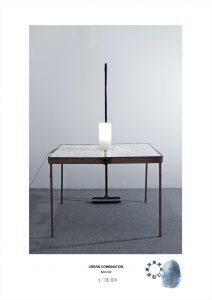 Arte contemporanea dell'artista Maurizio Di Feo. Combinazione in studio con tavolino in ferro e lampada. Milano.