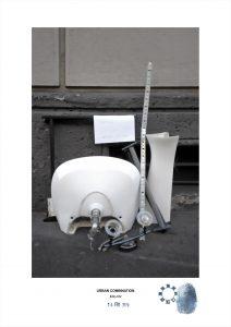 Arte contemporanea con installazioni casuali dell'artista Maurizio Di Feo. Combinazione urbana con lavandino sanitario, Milano.
