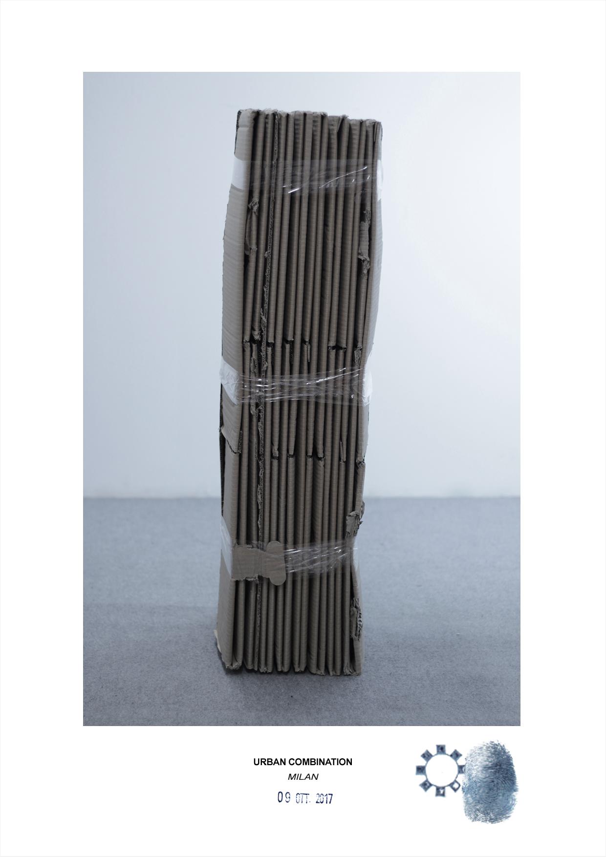 Arte contemporanea dell'artista Maurizio Di Feo. Combinazione in studio con cartone recuperato. Milano.